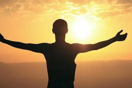 Woman holding arms out to sun