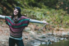 Positive, happy woman with arms outstretched