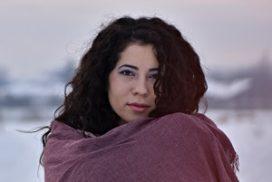 empathic woman in shawl
