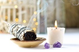 white sage and candle